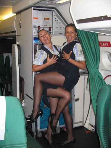 Two buxom stewardesses